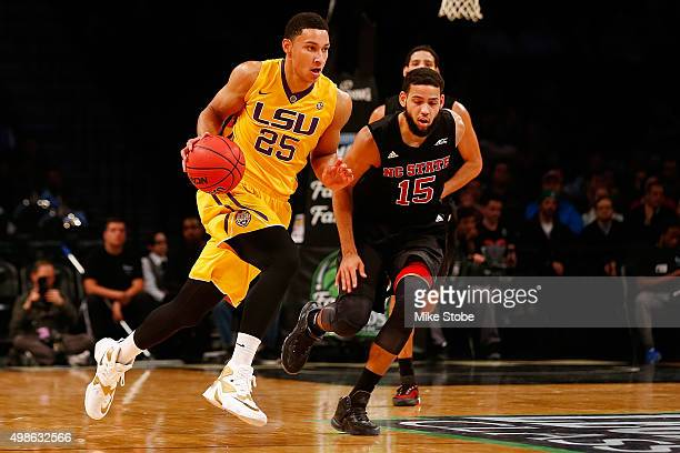 Ben Simmons of the LSU Tigers carries the ball against Cody Martin of the North Carolina State Wolfpack at Barclays Center on November 24 2015 in...