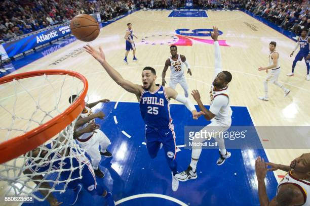 Ben Simmons of the Philadelphia 76ers attempts a shot against Dwyane Wade of the Cleveland Cavaliers in the second quarter at the Wells Fargo Center...