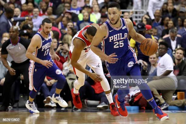 Ben Simmons of the Philadelphia 76ers dribbles the ball against the Washington Wizards in the first half at Capital One Arena on October 18 2017 in...