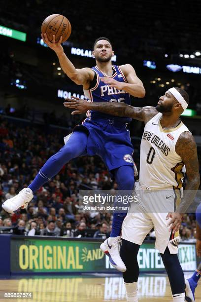 Ben Simmons of the Philadelphia 76ers drives against DeMarcus Cousins of the New Orleans Pelicans during the first half of a game at the Smoothie...
