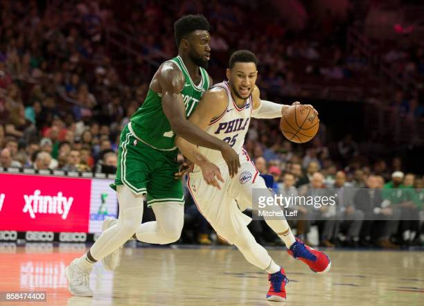Ben Simmons of the Philadelphia 76ers drives to the basket against Jaylen Brown of the Boston Celtics in the third quarter of the preseason game at...