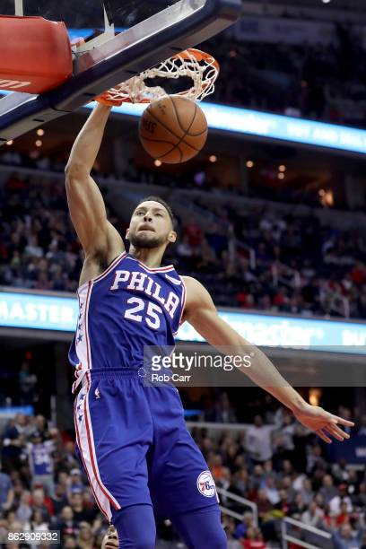Ben Simmons of the Philadelphia 76ers dunks the ball against the Washington Wizards in the first half at Capital One Arena on October 18 2017 in...