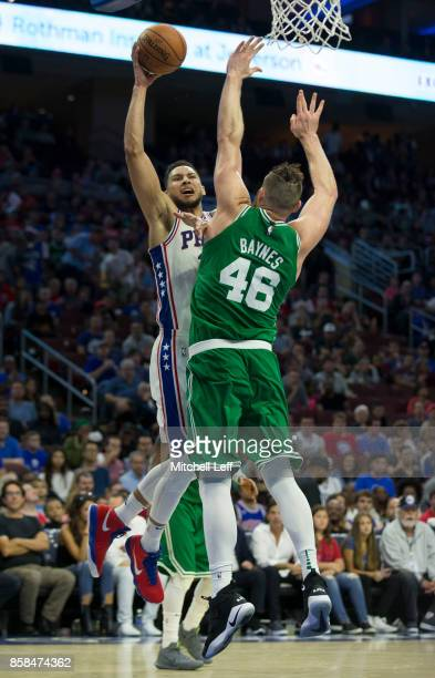 Ben Simmons of the Philadelphia 76ers goes up for a layup against Aron Baynes of the Boston Celtics in the third quarter of the preseason game at the...