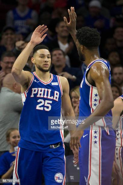 Ben Simmons of the Philadelphia 76ers high fives Joel Embiid after making a basket and getting fouled in the second quarter against the Los Angeles...