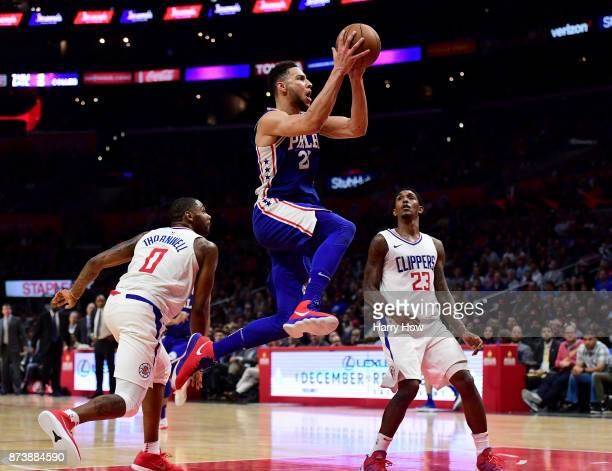 Ben Simmons of the Philadelphia 76ers scores on a layup past Sindarius Thornwell and Lou Williams of the LA Clippers during a 109105 win over the...