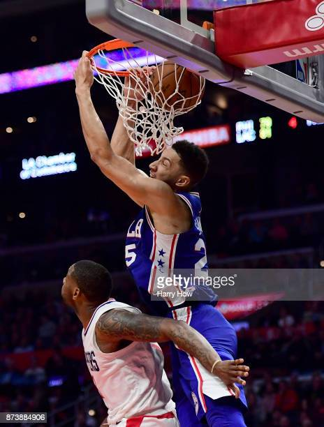 Ben Simmons of the Philadelphia 76ers scores on a reverse alleyoop over Sindarius Thornwell of the LA Clippers the LA Clippers during a 109105 win...
