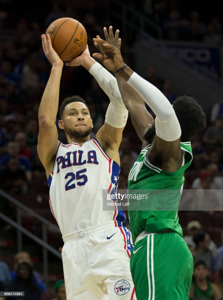 Ben Simmons #25 of the Philadelphia 76ers shoots the ball against Jaylen Brown #7 of the Boston Celtics in the third quarter of the preseason game at the Wells Fargo Center on October 6, 2017 in Philadelphia, Pennsylvania. The Celtics defeated the 76ers 110-102.