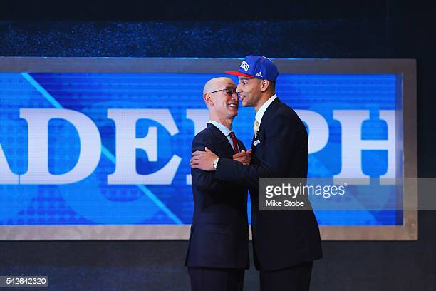 Ben Simmons shakes hands with Commissioner Adam Silver after being drafted first overall by the Philadelphia 76ers in the first round of the 2016 NBA...