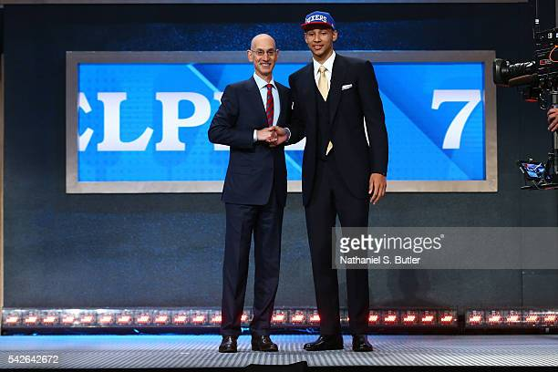 Ben Simmons shakes hands with NBA Commissioner Adam Silver after being selected number one overall by the Philadelphia 76ers during the 2016 NBA...