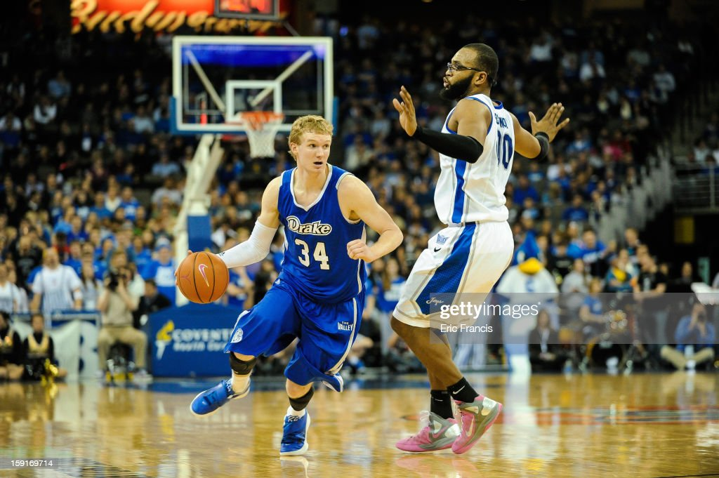 Ben Simons #34 of the Drake Bulldogs drives past Gregory Echenique #00 of the Creighton Bluejays during their game at the CenturyLink Center on January 8, 2013 in Omaha, Nebraska. Creighton defeated Drake 91-61.
