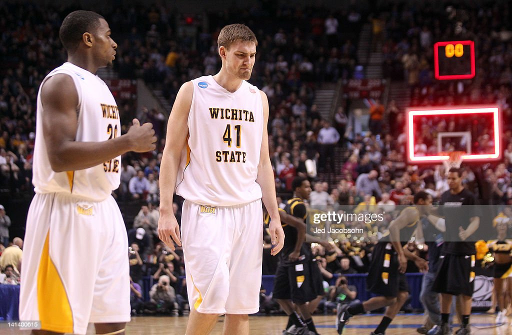 Ben Smith #20 and Garrett Stutz #41 of the Wichita State Shockers reacts after losing to the Virginia Commonwealth Rams 62-59 in the second round of the 2012 NCAA men's basketball tournament at Rose Garden Arena on March 15, 2012 in Portland, Oregon.