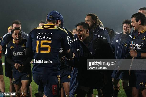 Ben Smith and Malakai Fekitoa celebarte after their win during the round 16 Super Rugby match between the Highlanders and the Chiefs at on May 30...