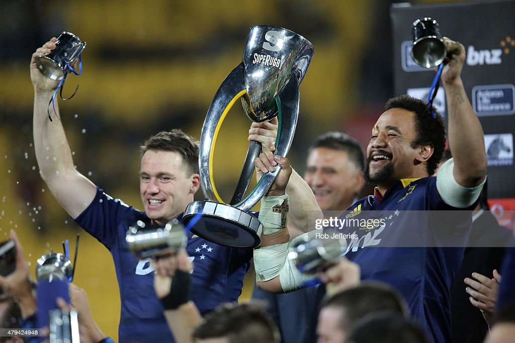 Ben Smith and Nasi Manu of the Highlanders hold aloft the Super Rugby Trophy during the Super Rugby Final match between the Hurricanes and the...
