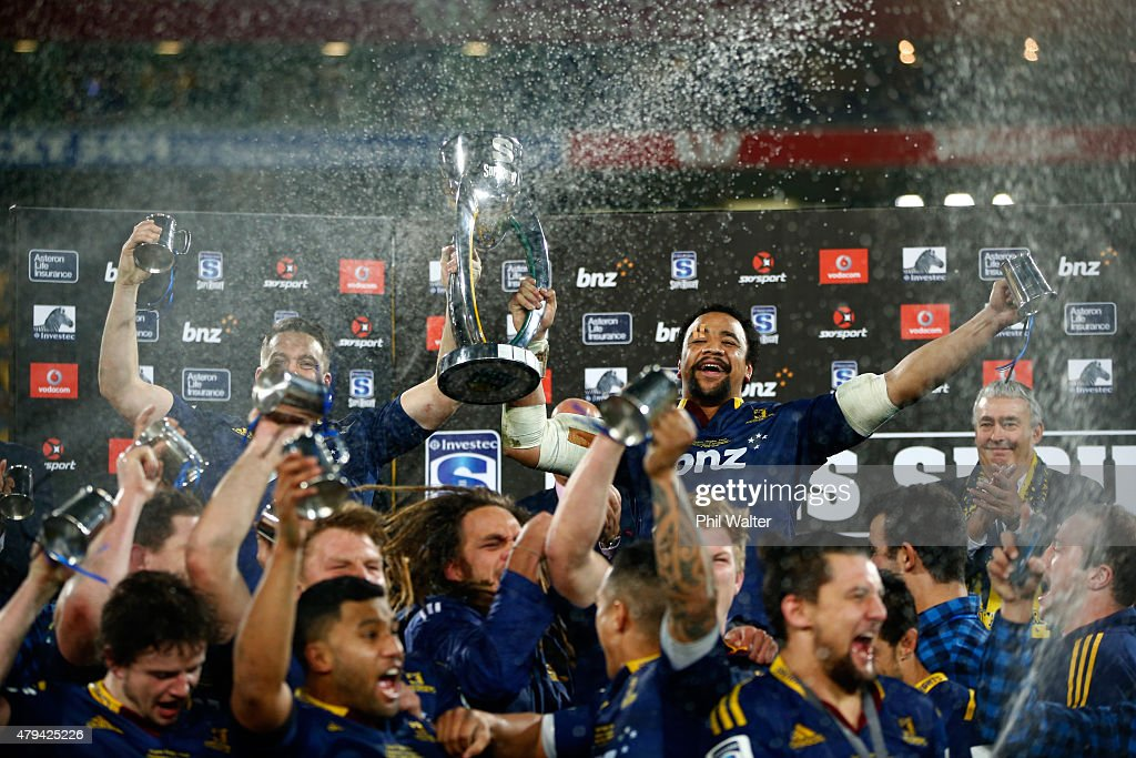 Ben Smith and Nasi Manu of the Highlanders hold up the trophy following the Super Rugby Final match between the Hurricanes and the Highlanders at...