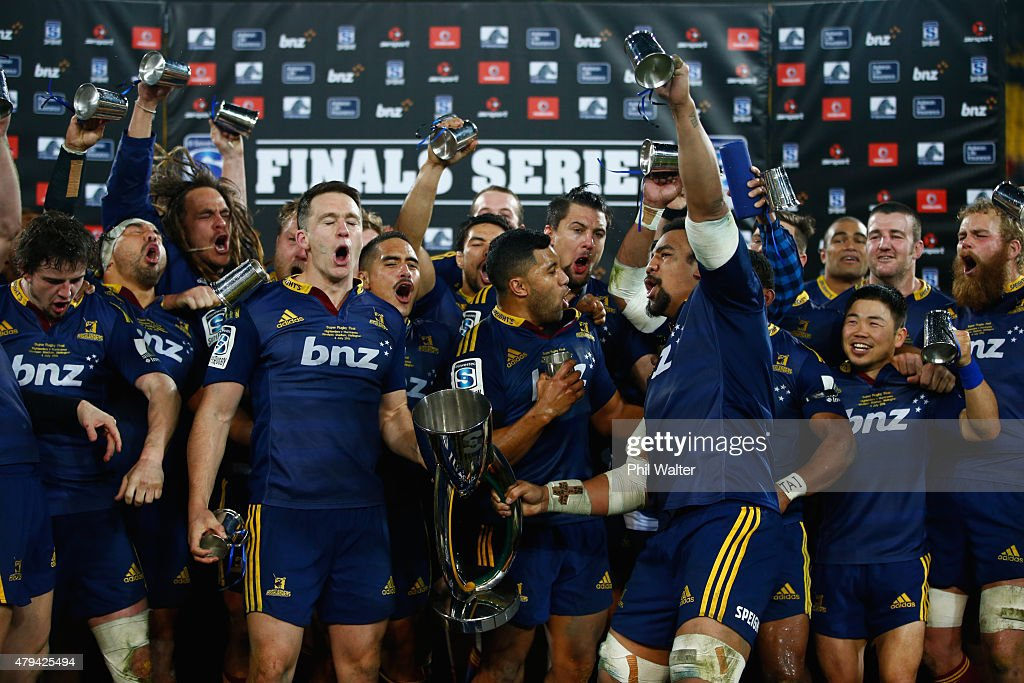 Ben Smith and Nasi Manu of the Highlanders hold up the trophy following the Super Rugby Final match between the Hurricanes and the Highlanders at Westpac Stadium on July 4, 2015 in Wellington, New Zealand.