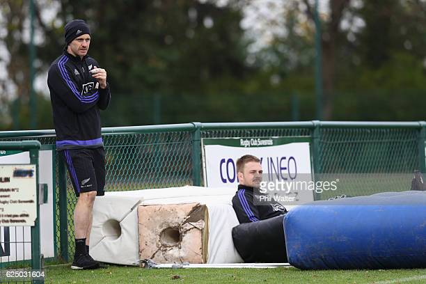 Ben Smith and Sam Cane of the New Zealand All Blacks sit out training injured at the Suresnes Rugby Club on November 22 2016 in Paris France
