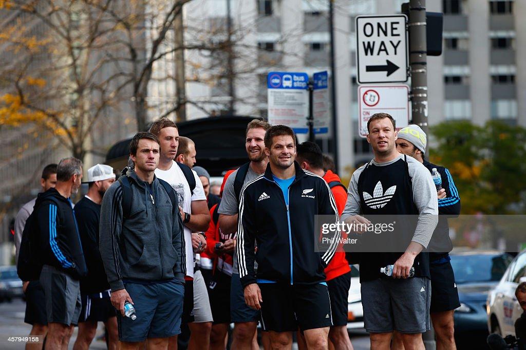 Ben Smith Luke Romanos Kieran Read Richie McCaw and Wyatt Crockett of the New Zealand All Blacks take in a bit of sightseeing as they walk along...