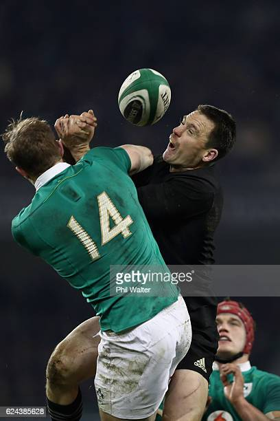Ben Smith of New Zealand and Andrew Trimble of Ireland contest the ball during the international rugby match between Ireland and the New Zealand All...