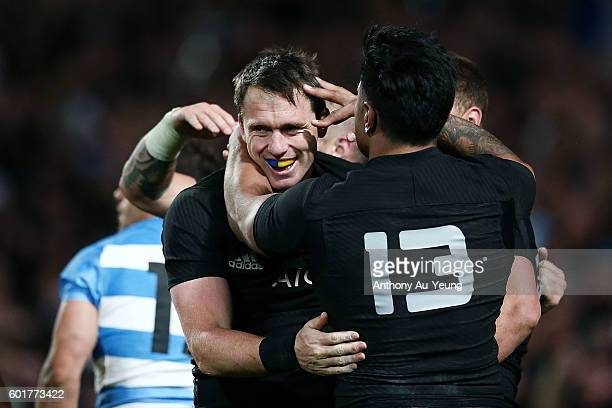 Ben Smith of New Zealand is mobbed by teammates after scoring a try during the Rugby Championship match between the New Zealand All Blacks and...