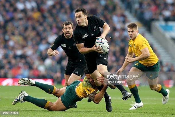 Ben Smith of New Zealand is tackled by Israel Folau of Australia during the 2015 Rugby World Cup Final match between New Zealand and Australia at...