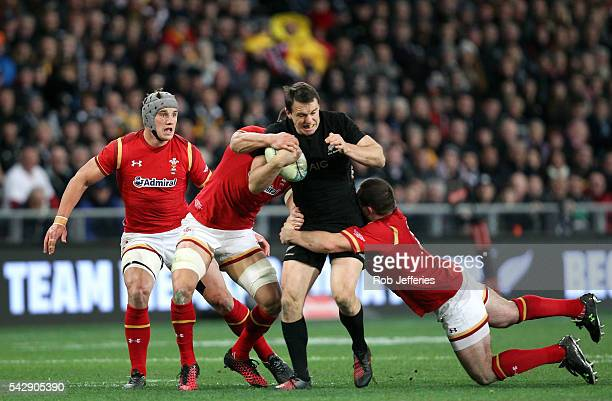 Ben Smith of New Zealand looks to bust the Wales defence during the International Test match between the New Zealand All Blacks and Wales at Forsyth...