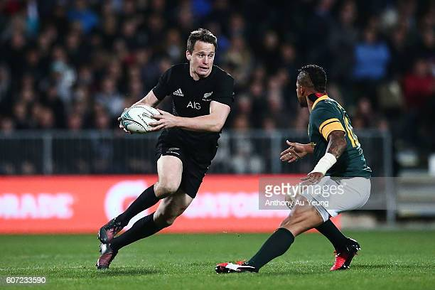 Ben Smith of New Zealand makes a run at Elton Jantjies of South Africa during the Rugby Championship match between the New Zealand All Blacks and the...
