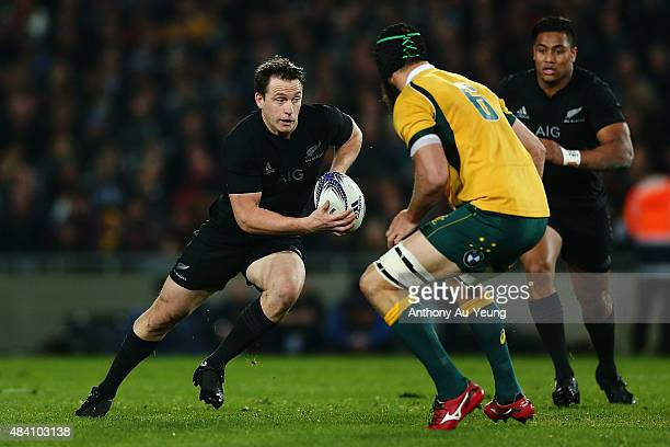 Ben Smith of New Zealand makes a run at Scott Fardy of Australia during The Rugby Championship Bledisloe Cup match between the New Zealand All Blacks...