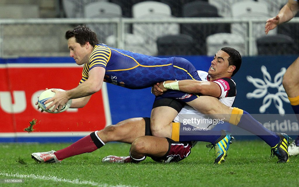 Ben Smith of Otago on his way to scoring a try during the round eight ITM Cup match between Otago and North Harbour at Forsyth Barr Stadium on September 18, 2012 in Dunedin, New Zealand.