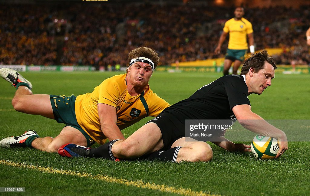 Ben Smith of the All Blacks beats the tackle of <a gi-track='captionPersonalityLinkClicked' href=/galleries/search?phrase=Michael+Hooper&family=editorial&specificpeople=676799 ng-click='$event.stopPropagation()'>Michael Hooper</a> of the Wallabies to score during The Rugby Championship Bledisloe Cup match between the Australian Wallabies and the New Zealand All Blacks at ANZ Stadium on August 17, 2013 in Sydney, Australia.