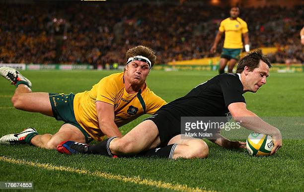 Ben Smith of the All Blacks beats the tackle of Michael Hooper of the Wallabies to score during The Rugby Championship Bledisloe Cup match between...