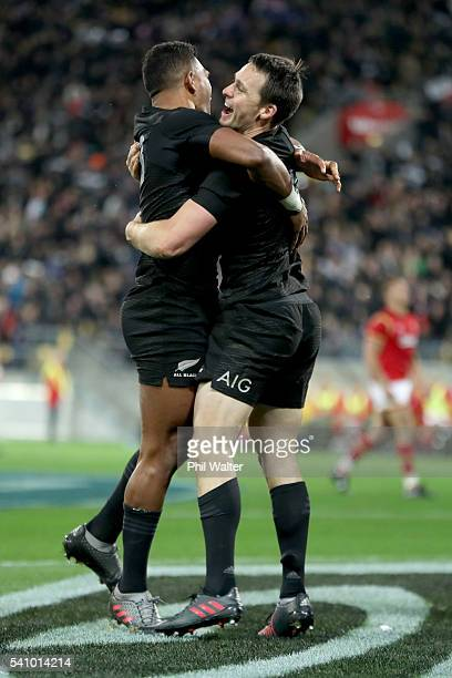Ben Smith of the All Blacks celebrates his try with Seta Tamanivalu during the International Test match between the New Zealand All Blacks and Wales...