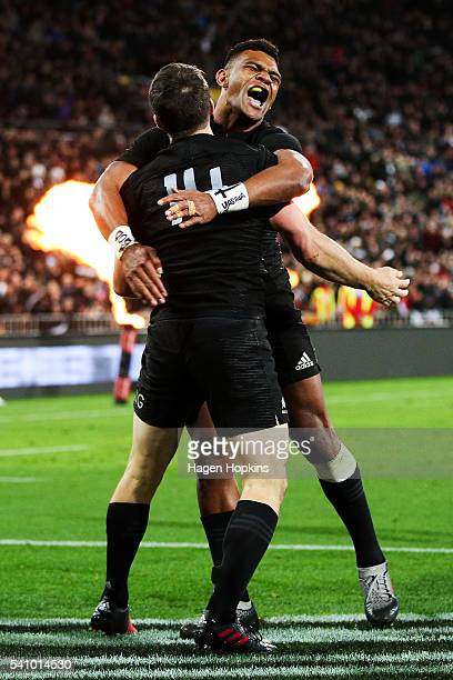 Ben Smith of the All Blacks celebrates his try with teammate Seta Tamanivalu during the International Test match between the New Zealand All Blacks...