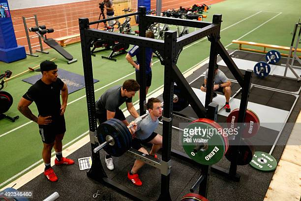 Ben Smith of the All Blacks is assisted on the squat rack by Beauden Barrett and Malakai Fekitoa during a New Zealand All Blacks gym session at...