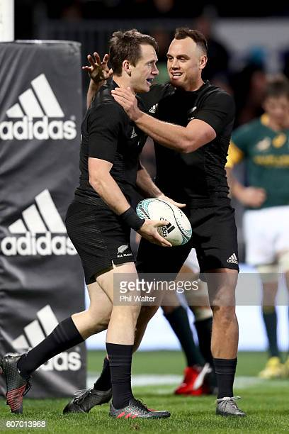 Ben Smith of the All Blacks is congratulated on his try by Israel Dagg during the Rugby Championship match between the New Zealand All Blacks and the...