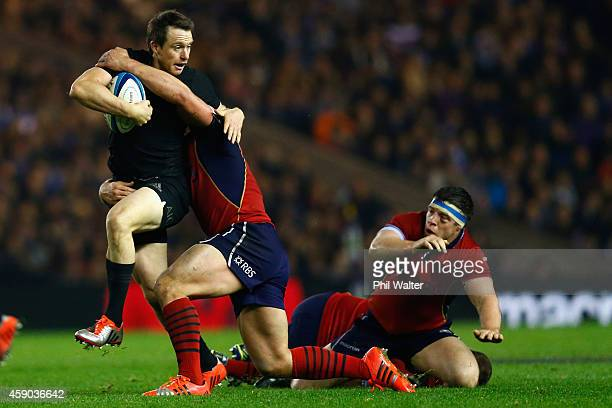 Ben Smith of the All Blacks is tackled by Ross Ford of Scotland during the Viagogo Autumn International match between Scotland and New Zealand at...