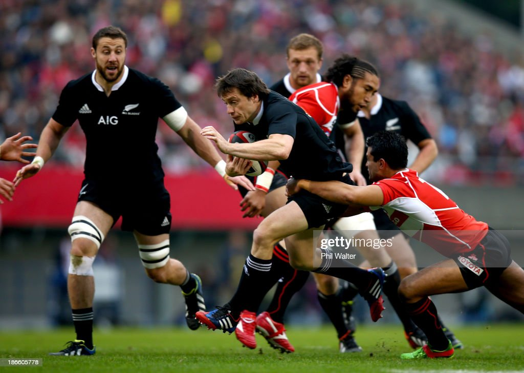 Ben Smith of the All Blacks is tackled during the International Rugby Test Match between Japan and the New Zealand All Blacks at Prince Chichibu Memorial Rugby Stadium on November 2, 2013 in Tokyo, Japan.