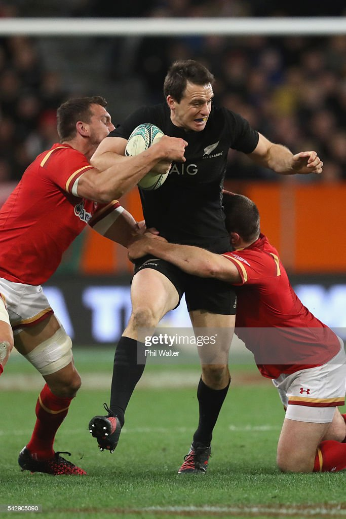 <a gi-track='captionPersonalityLinkClicked' href=/galleries/search?phrase=Ben+Smith+-+Rugby+Union+Player&family=editorial&specificpeople=11650283 ng-click='$event.stopPropagation()'>Ben Smith</a> of the All Blacks is tackled during the International Test match between the New Zealand All Blacks and Wales at Forsyth Barr Stadium on June 25, 2016 in Dunedin, New Zealand.
