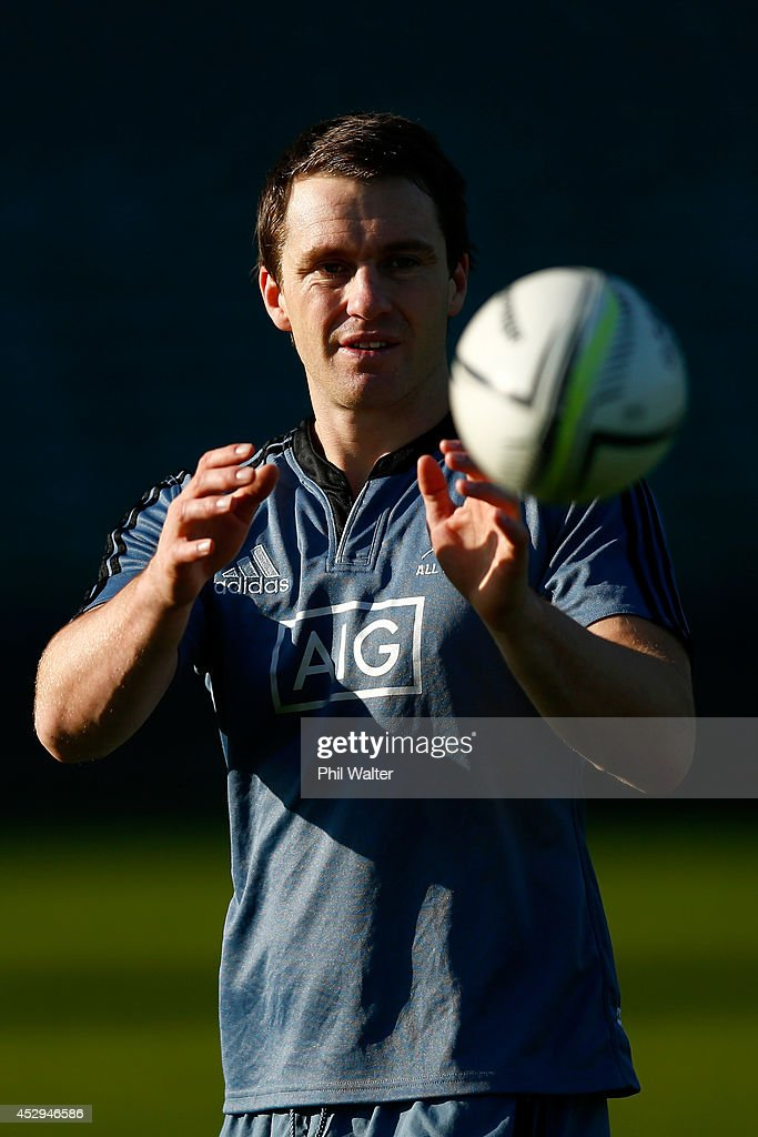 Ben Smith of the All Blacks passes during a New Zealand All Blacks training session at North Harbour Stadium on July 31, 2014 in Auckland, New Zealand.