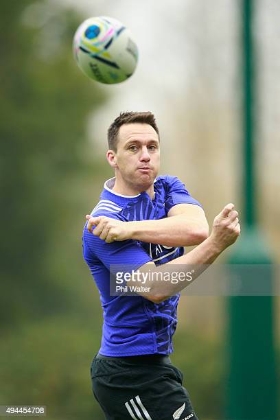 Ben Smith of the All Blacks passes during a New Zealand All Blacks training session at Pennyhill Park on October 27 2015 in Bagshot United Kingdom