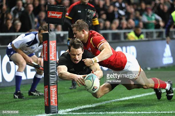 Ben Smith of the All Blacks scores a try in the tackle of Hallam Amos of Wales during the International Test match between the New Zealand All Blacks...