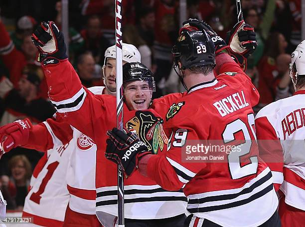 Ben Smith of the Chicago Blackhawks celebrates a second period goal with Bryan Bickell against the Detroit Red Wings at the United Center on March 16...