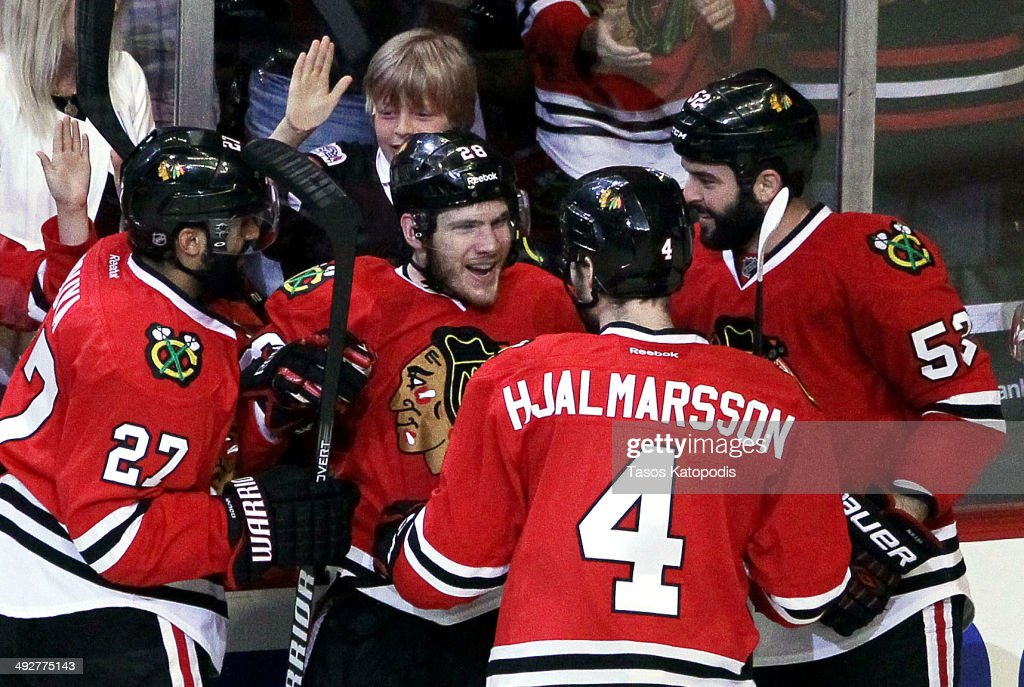 Ben Smith #28 of the Chicago Blackhawks celebrates with teammates after his goal against the Los Angeles Kings in the second period in Game Two of the Western Conference Final during the 2014 Stanley Cup Playoffs at United Center on May 21, 2014 in Chicago, Illinois.