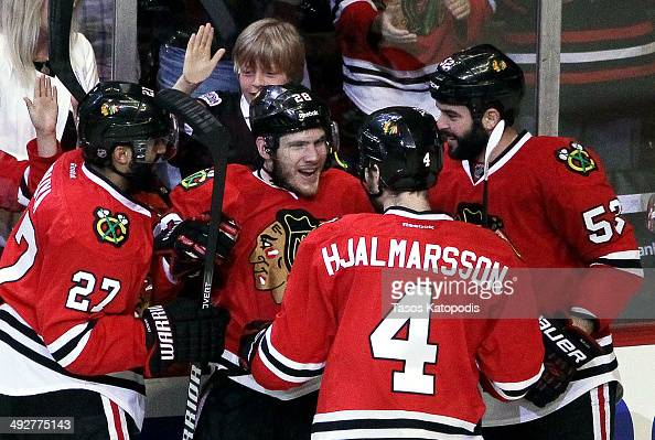 Ben Smith of the Chicago Blackhawks celebrates with teammates after his goal against the Los Angeles Kings in the second period in Game Two of the...