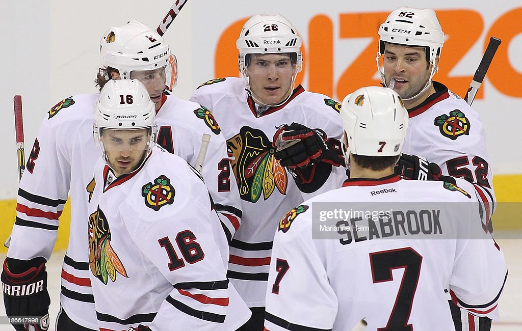 Ben Smith #28 (centre) of the Chicago Blackhawks is congratulated by teammates after scoring a goal in third period action in an NHL game against the Winnipeg Jets at the MTS Centre on November 2, 2013 in Winnipeg, Manitoba, Canada.