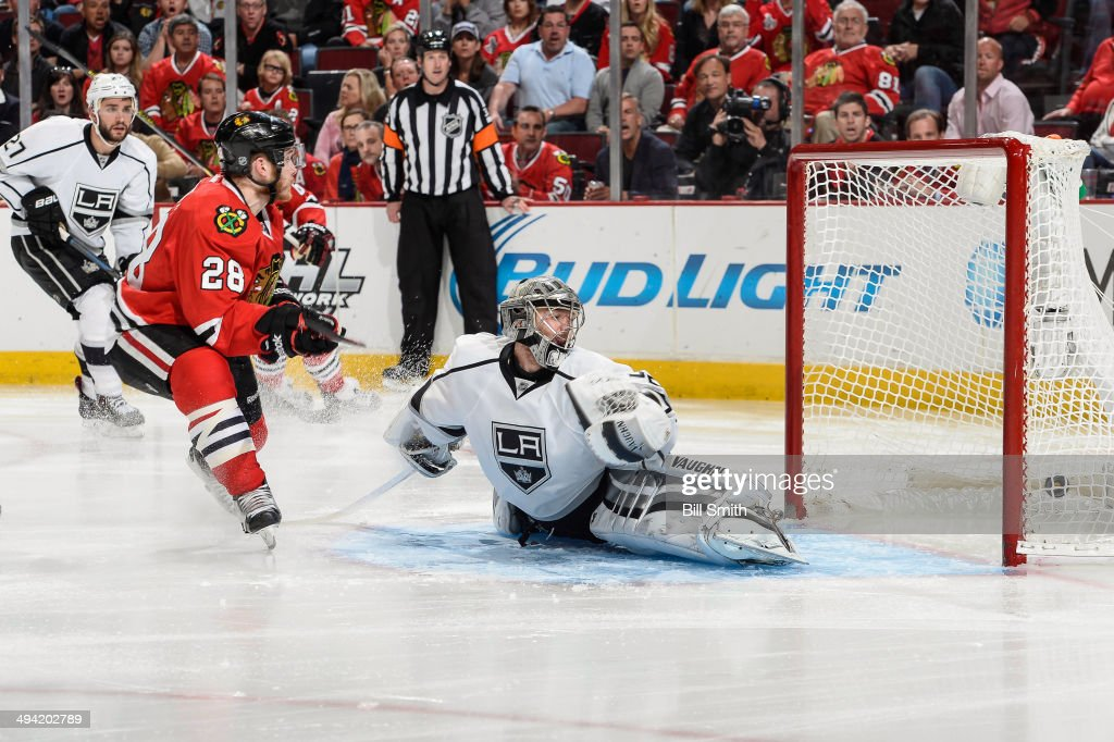 Ben Smith #28 of the Chicago Blackhawks scores on goalie <a gi-track='captionPersonalityLinkClicked' href=/galleries/search?phrase=Jonathan+Quick&family=editorial&specificpeople=2271852 ng-click='$event.stopPropagation()'>Jonathan Quick</a> #32 of the Los Angeles Kings in the third period in Game Five of the Western Conference Final during the 2014 NHL Stanley Cup Playoffs at the United Center on May 28, 2014 in Chicago, Illinois.
