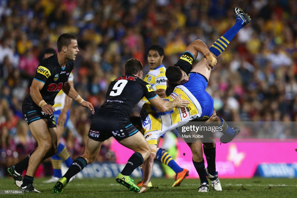 Ben Smith of the Eels is picked up and tackled during the round seven NRL match between the Penrith Panthers and the Parramatta Eels at Centrebet Stadium on April 29, 2013 in Penrith, Australia.
