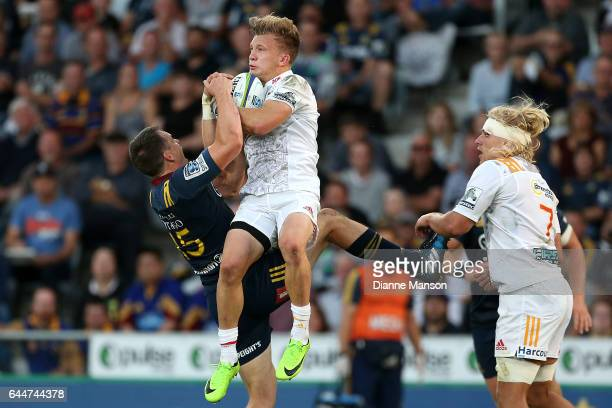Ben Smith of the Highlanders and Damian McKenzie of the Chiefs compete for high ball during the round one Super Rugby match between the Highlanders...