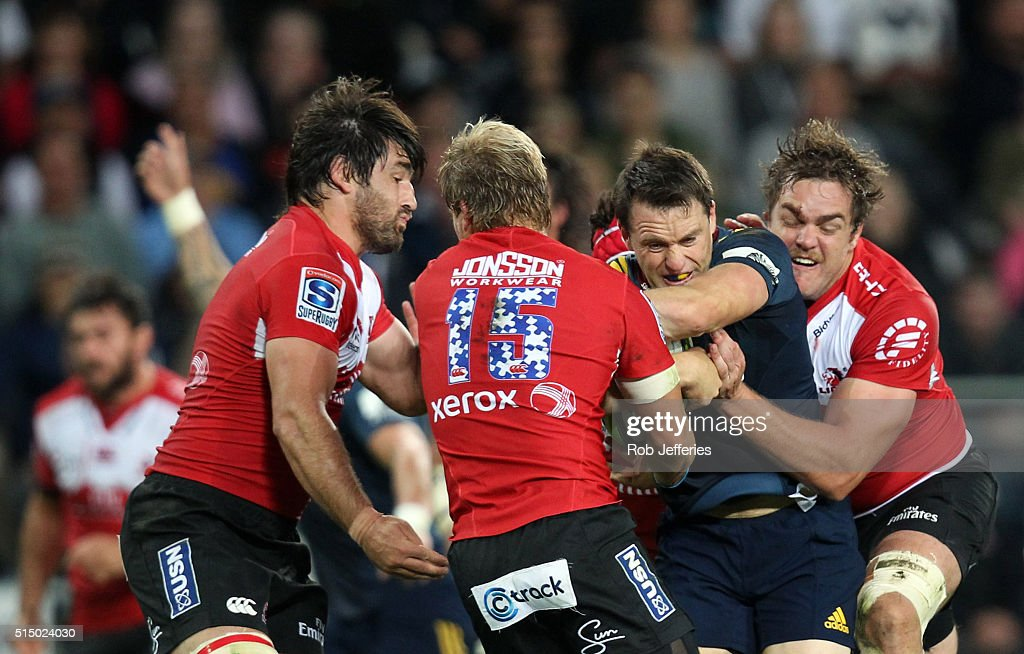 Ben Smith of the Highlanders attempts to bust the Lions defence during the round three Super Rugby match between the Highlanders and the Lions at Rugby Park on March 12, 2016 in Dunedin, New Zealand.
