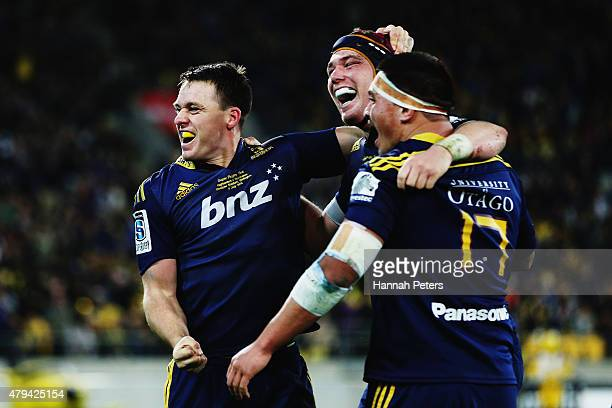 Ben Smith of the Highlanders celebrates with Joe Wheeler of the Highlanders and Daniel LienertBrown of the Highlanders after winning the Super Rugby...