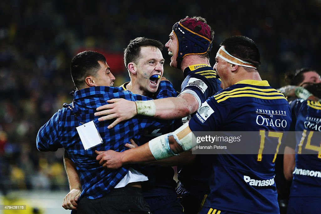Ben Smith of the Highlanders celebrates with Joe Wheeler of the Highlanders and Daniel Lienert-Brown of the Highlanders after winning the Super Rugby Final match between the Hurricanes and the Highlanders at Westpac Stadium on July 4, 2015 in Wellington, New Zealand.